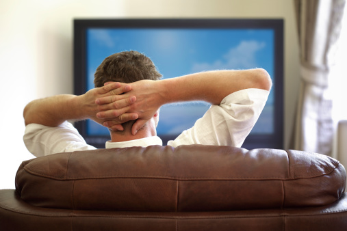 Kick back, turn on the TV and...get paid? (Thinkstock)