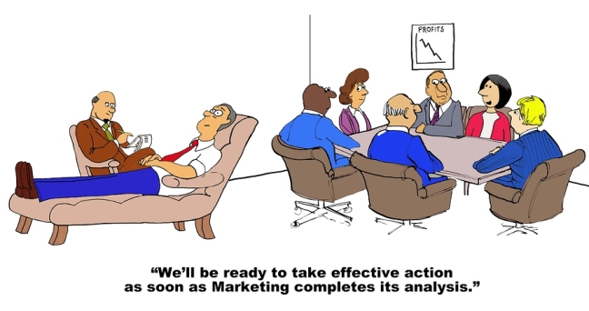 Business cartoon showing a man in therapy in the foreground, in the background people are at a business meeting and businesswoman says, 'We'll be ready to take effective action as soon as Marketing completes its analysis'.